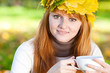 young redhead teenager woman in a wreath of maple leaves with cu