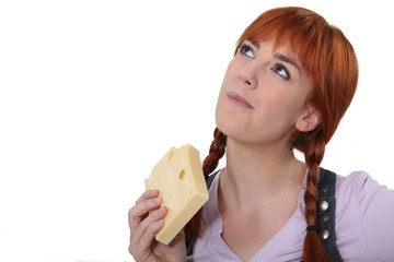 Woman eating block of cheese