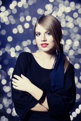 Portrait of beautiful girl with bokeh at background.