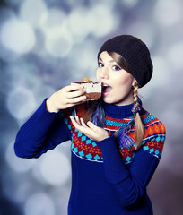 Lovely girl in sweater with cake.