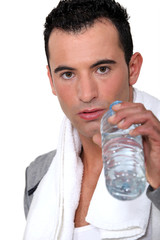 Man drinking water after work-out