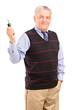 Smiling mature gentleman holding a car key