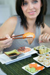 Brunette eating sushi