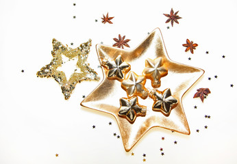 Christmas decoration with anis and  golden stars