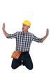 Builder pushing against imaginary walls
