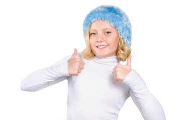 smiling girl makes thumbs up sign isolated over white background