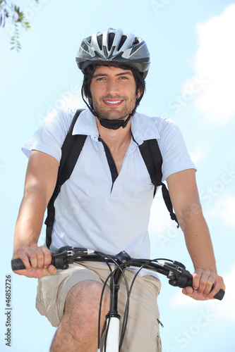 Young on bike with helmet