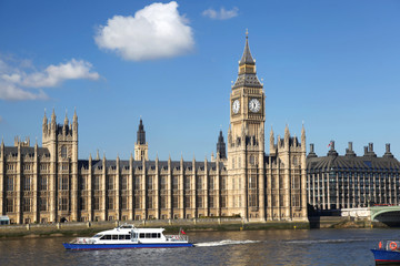 Big Ben with boat in London, UK