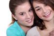 Two female friends hugging.