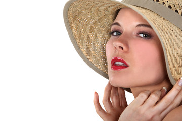 Blond woman posing in straw hat