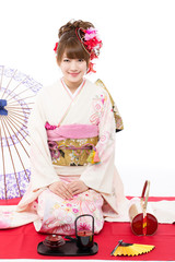 Beautiful kimono woman on white background