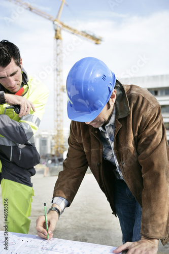 Foreman and colleague working on site