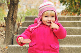 toddler girl pointing her nose