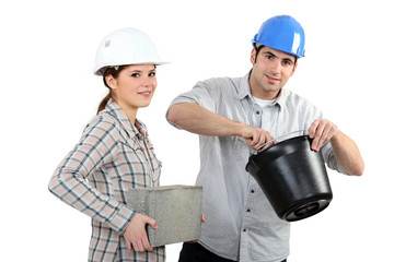 Man and woman with brick and cement