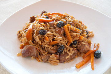 Pilaf with turkey, carrots, spices, and dried fruits