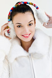 Beautiful girl with  putting on ear muffs.