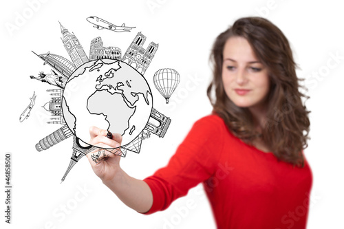 Young woman drawing a globe on whiteboard