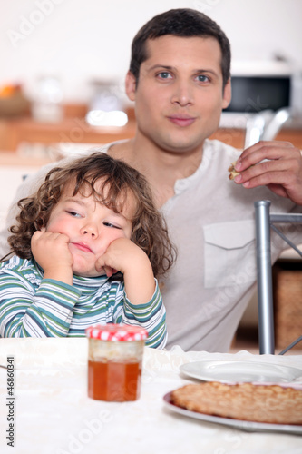 Father having crepes with his child