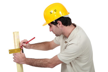 Man marking wood with setsquare