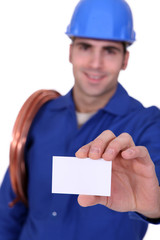 Plumber with a businesscard