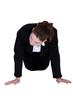 Businesswoman doing knee push-ups
