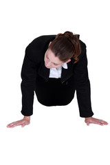Businesswoman doing knee push-ups
