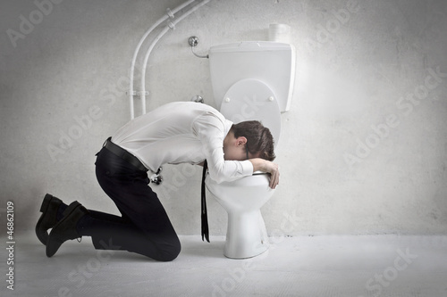 Young Businessman Vomiting