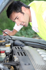 Man looking at a car engine