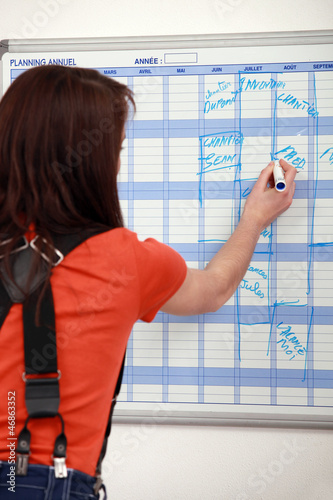 female apprentice noting down appointments