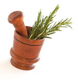 Fresh rosemary herb in wooden mortar with pestle