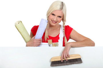Blond woman with upholstery tools