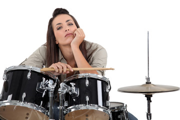 Woman sat behind drum kit
