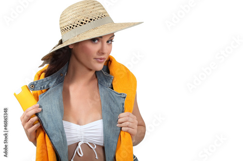 Woman with a towel and suncream