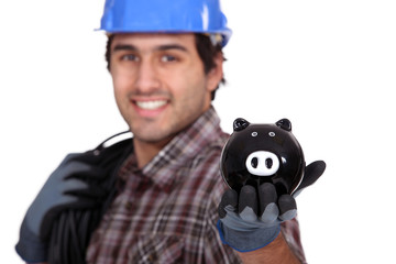 Electrician with a piggy bank