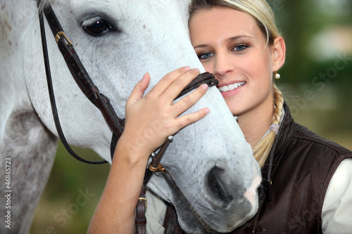 Leinwandbild Motiv Woman and horse