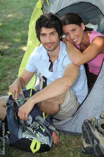 Couple sat by tent