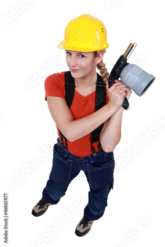Tradeswoman holding a blowtorch