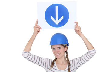 Woman holding a road sign