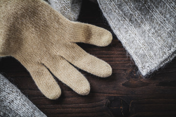 glove on wool sweater