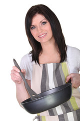 Brunette woman with pan