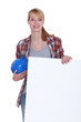 Woman with a hard hat and a blank board