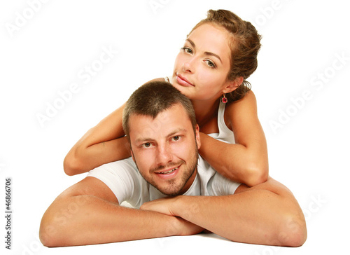 Happy couple lying on floor and smiling