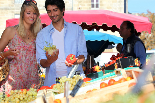 Young couple at a market stall