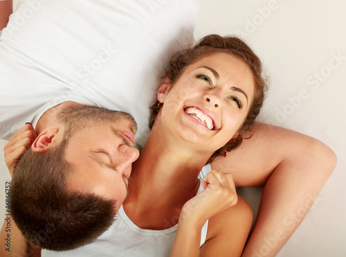 young lovely couple lying on the floor