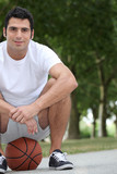 Man crouching on basketball