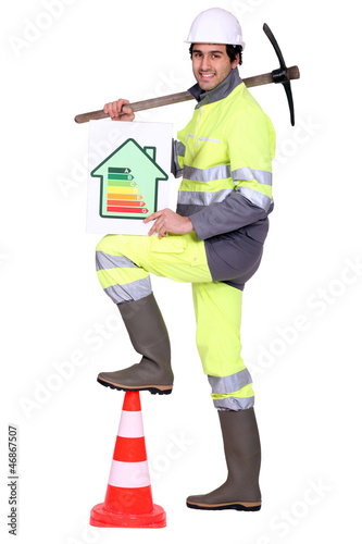 Construction worker holding a pickaxe and an energy rating