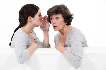 Woman whispering to her mother