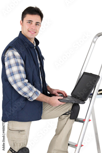 Tiler stood with ladder and laptop