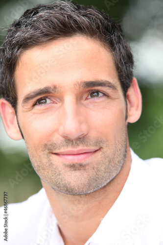 Close-up of dark haired man