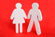 White male and female figures on a red background